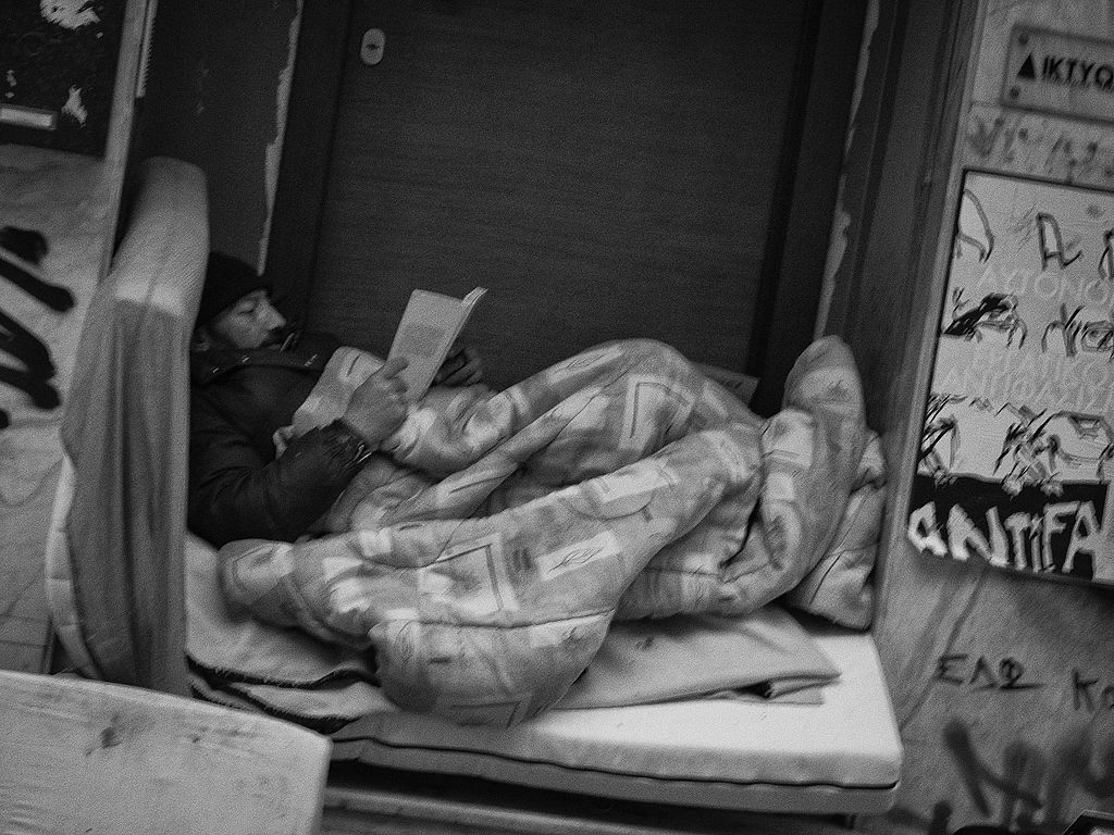 Homeless reading Athens Exarchia 15824614293