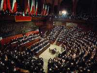 29 Dec 1971, Rome, Italy --- Senators and Deputies fill the flag-draped Chamber of Deputies to witness President Giovanni Leone (standing at second highest row of desks facing deputies) take the oath of office. --- Image by © Bettmann/CORBIS